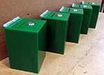 Zelená kasička osazena schránkovým zámkem