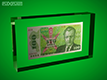 Example of US dollar bill laminated between two acrylic plates
