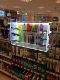Special illuminated display stand integrated into shelf in retail spaces.